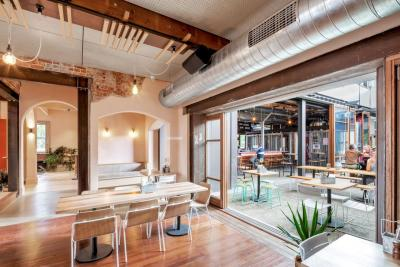 Sparkke at the Whitmore delivers a full dining experience, beer garden and a nano-brewery, as well as rooftop over Whitmore Square.